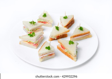 Mini sandwiches on a plate on a white background