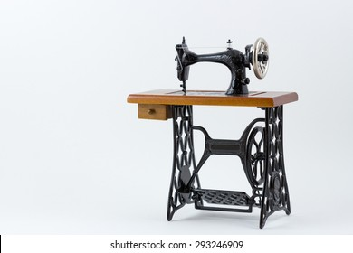 Mini sewing machine on white background