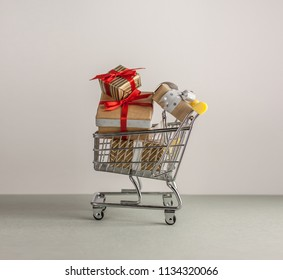 mini shopping cart with boxes with presents