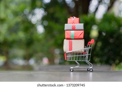 mini shopping cart with gift boxes