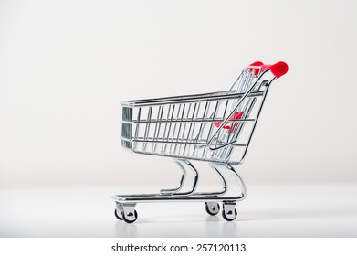 Mini shopping trolley, isolated on white background