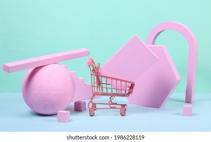 Mini shopping trolley with pink geometric shapas on blue background. Concept art. Minimalism
