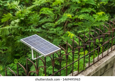 The Mini Solar cell With Green Background, Energy Saving, Green Energy