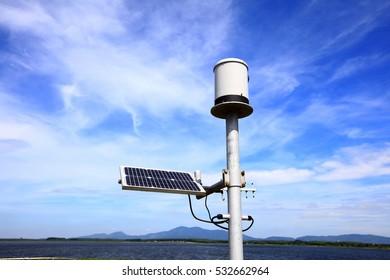 Mini Solar pane for street light in the background.