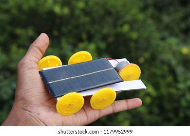 mini solar powered car working model,mini solar cell is used to power the direct current motor this unique mini solar car has 5 wheels and it works on green energy because of usage of the solar panel
