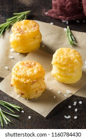 Mini stacks of potato gratin with cheese and rosemary, beautiful tasty appetizer