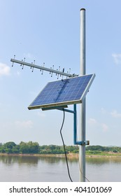 Mini stand electric solar cell on nature view.