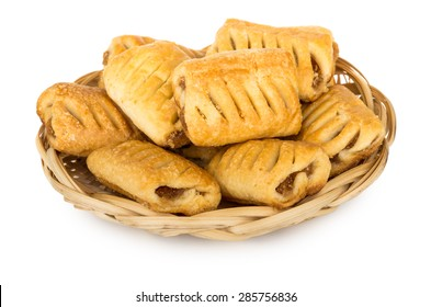Mini strudels in wicker basket isolated on white background