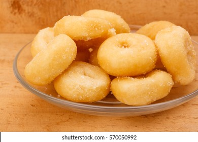 mini sugar coated doughnuts piled on plate hight calorie