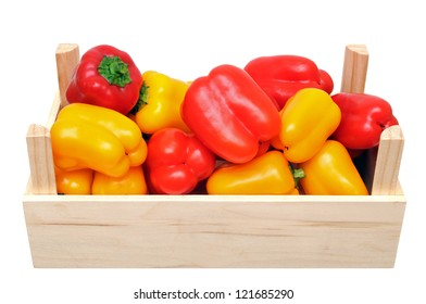 mini sweet bell peppers in crate isolated on white background