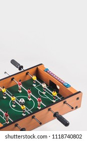 Mini table football foosball soccer with players and ball. isolated.