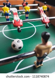 Mini table football foosball soccer with players and ball.
