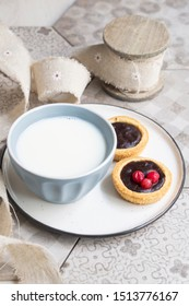 mini tart and a cup of milk