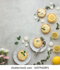 Mini Tarts with custard lemon cream and lemons. flatlay. copy spase