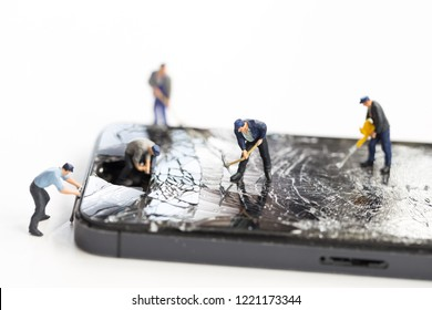 Mini technicians repairing broken screen phones caused by falling, Smartphone hitting the street and maintenance cracked mobile phone