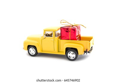 Mini toy car and gift box on white background