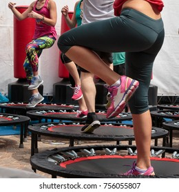 Mini Trampoline Workout: Girl doing Fitness Exercise in Class at Gym.