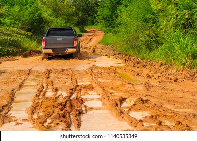 Mini truck running on the clay road in the countryside