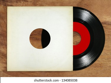 Mini vinyl with cover on wooden table