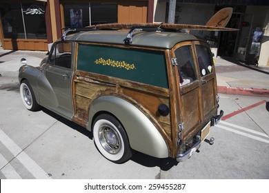 Mini woody station wagon with surf board, Ventura, California, USA, 05.02.2014