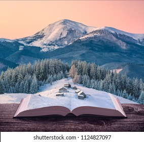 Miniature alpine mountain village at winter on the pages of an open magical book. Majestic landscape. Nature and education concept.