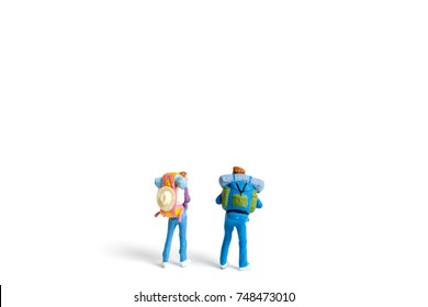 Miniature Backpacker  isolated on white background ,Travel concept