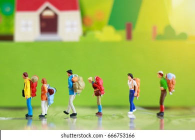 Miniature backpacker, travel or business concept.