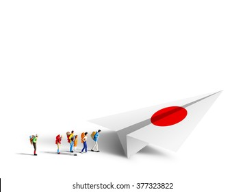 Miniature backpackers walking to the paper japan airplane on white background