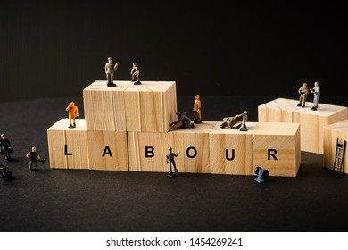 "Miniature Builder Figure with wooden blocks and ""LABOUR"" wordings. Labour Day Concept"