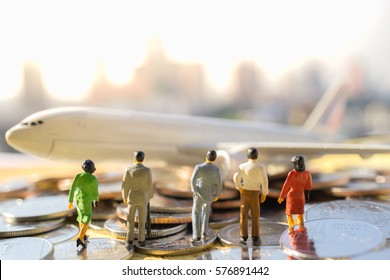 Miniature business people : businesses team walking to airplane on world map with copyspace for travel around the world, business trip traveler adviser agency or online world wide marketing concept.