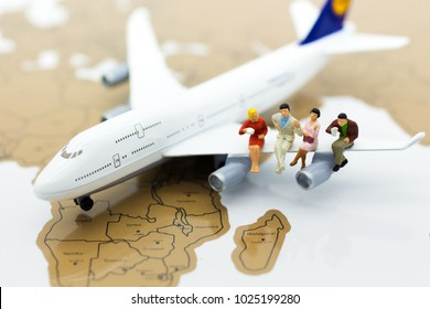 Miniature business people : businessman with plane. Image use for business travel, business trip travel advisory agency of transportation concept.