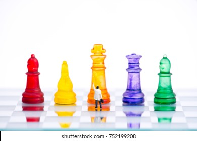 miniature business people with colorful glass chess,business concept