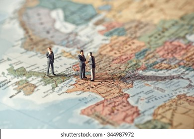 Miniature business people on map of Europe. Color tone tuned.