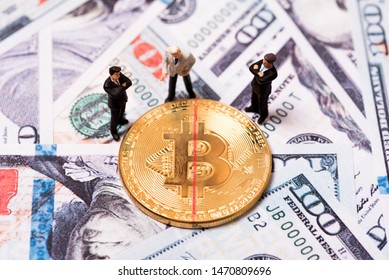 miniature businessman and bitcoins marked with red line halving concept