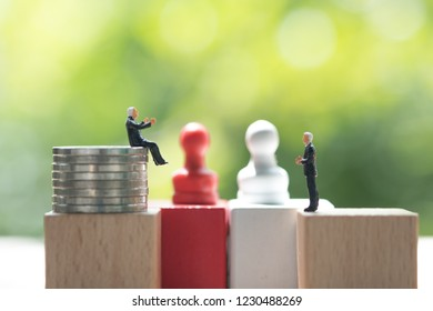 Miniature businessman face to face for negotiating in business. Strategy concept and business competition concept