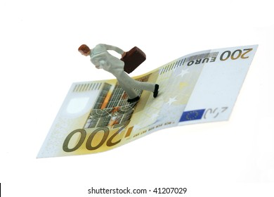 miniature businessman figurine running on a euro banknote