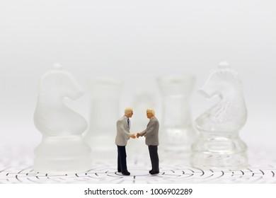 Miniature businessman: Businessman make deal for business together. Image use for business concept.