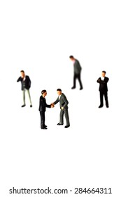 Miniature businessmen