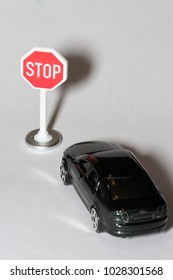 miniature of a car in front of a stop sign