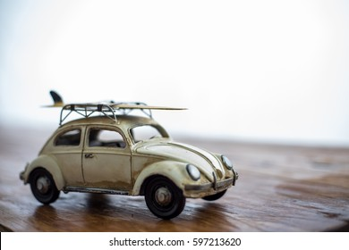 Miniature car with surf board