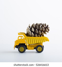 Miniature Car Truck With Wooden Fir Tree Cone On Isolated White Background