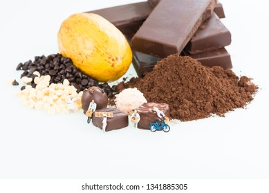 Miniature chefs and cocoa over white background