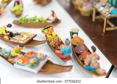 Miniature clay figurine of retro Thailand's floating market