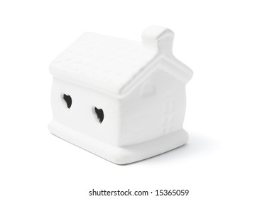Miniature Clay House on White Background