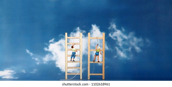 Miniature climbers climbing a wooden ladder against the backdrop of the blue sky. The concept of gender discrimination in employment and promotion.