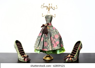 Miniature clothes hanger and shoes on a white background
