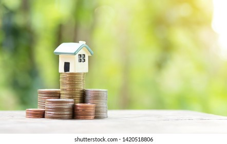 Miniature colorful house on stack coins using as property and finance concept