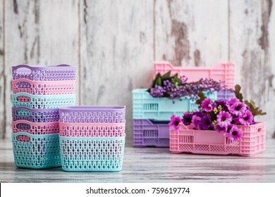 Miniature colorful plastic baskets for household use on white background
