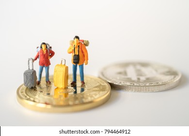 Miniature concept : Group of young traveler traveling / standing on  Bit Coin Currency of the world, business trip traveler adviser agency or online world wide marketing Bitcoins banking concept