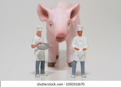 miniature of a cook with a giant pig
